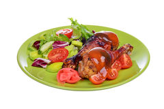 Grilled chicken drumstick with vegetables on the plate isolated Royalty Free Stock Image