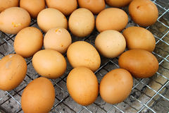 Grilled chicken eggs. Over gridiron and low heat from natural charcoal royalty free stock photography