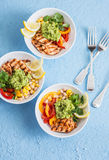 Grilled chicken fajitas bowls on a blue background, top view. Stock Photos