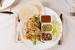 Grilled Chicken Fajitas with Fixings on Plate Royalty Free Stock Images