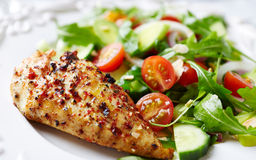 Grilled chicken fillet with colorful salad Royalty Free Stock Photography