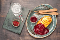 Grilled chicken fillet with cranberry sauce. Grilled chicken breaswith berry sauce Royalty Free Stock Photography