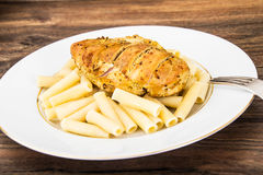 Grilled Chicken Fillet with Pasta Royalty Free Stock Photos