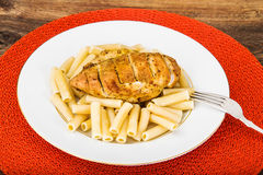 Grilled Chicken Fillet with Pasta Stock Images