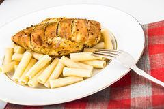 Grilled Chicken Fillet with Pasta Stock Photos