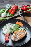 Chicken fillet on plate with rice royalty free stock photo
