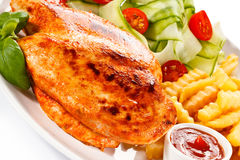 Grilled chicken fillet with potatoes Royalty Free Stock Photos