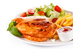 Grilled chicken fillet with potatoes Royalty Free Stock Images