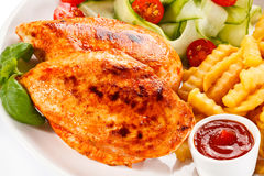 Grilled chicken fillet with potatoes Royalty Free Stock Photo