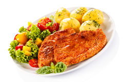 Grilled chicken fillet with potatoes Stock Photography