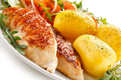 Grilled chicken fillet with potatoes Royalty Free Stock Image
