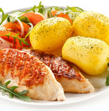 Grilled chicken fillet with potatoes Royalty Free Stock Photography