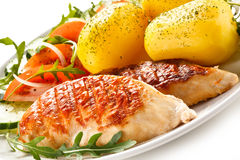 Grilled chicken fillet with potatoes Stock Photos