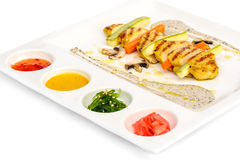 Grilled chicken fillet and squash with sauces Stock Photos