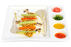 Grilled chicken fillet and squash with sauces Royalty Free Stock Photography