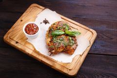 Grilled chicken fillet with tomato sauce and herbs royalty free stock photos