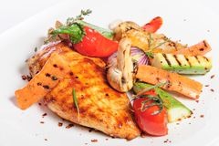 Grilled chicken fillet and vegetables Stock Image