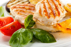 Grilled chicken fillets Stock Images