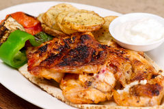 Grilled chicken fillets, with potatoes and vegetables and mayo garlic dip.  Royalty Free Stock Photography
