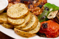 Grilled chicken fillets, with potatoes and vegetables and mayo garlic dip.  Stock Photos