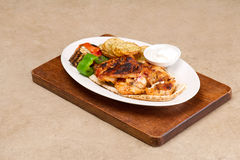 Grilled chicken fillets, with potatoes and vegetables Stock Photography