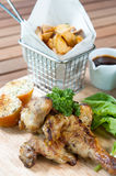Grilled chicken with French fries Stock Images