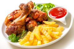 Grilled chicken with french fries Royalty Free Stock Photography