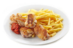 Grilled chicken and french fries Royalty Free Stock Photo