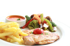 Grilled chicken, frenh fries and fried vegetables. And ketchup Stock Photo