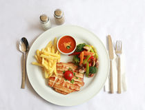 Grilled chicken, frenh fries and fried vegetables. And ketchup Royalty Free Stock Images