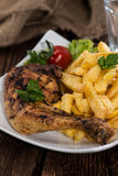 Grilled Chicken with fries Stock Photo