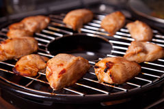 Grilled chicken on gas grill royalty free stock photos