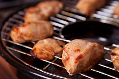 Grilled chicken on gas grill stock images
