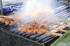 Grilled chicken on the grill Royalty Free Stock Images