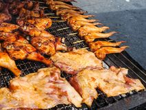 Grilled chicken. On the grill for the party Royalty Free Stock Photography