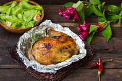 Grilled chicken ham marinated in balsamic sauce, spicy Italian herbs and fresh lemon. Restaurant supply on a wooden Stock Images
