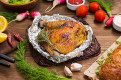 Grilled chicken ham marinated in balsamic sauce, spicy Italian herbs and fresh lemon. Restaurant supply on a wooden Stock Photo