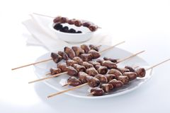 Grilled chicken hearts on skewers Stock Photo