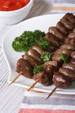 Grilled chicken hearts on skewers and sauce closeup Stock Image