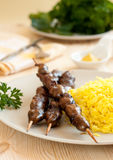 Grilled chicken hearts with turmeric rice Royalty Free Stock Images