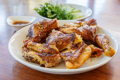 Grilled chicken KAIYANG Thai food on wooden background Stock Image
