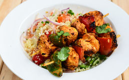 Grilled chicken kebab with couscous Royalty Free Stock Photo