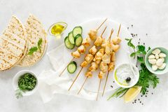Grilled chicken kebab on skewers and traditional Greek tzatziki yogurt sauce royalty free stock photos