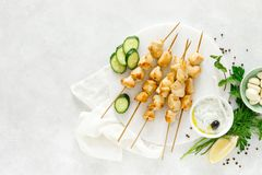 Grilled chicken kebab on skewers and traditional Greek tzatziki yogurt sauce stock photo