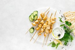 Grilled chicken kebab on skewers and traditional Greek tzatziki yogurt sauce royalty free stock images
