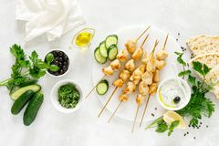 Grilled chicken kebab on skewers and traditional Greek tzatziki yogurt sauce royalty free stock image