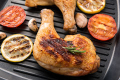 Grilled chicken lag and vegetables in a pan Stock Photos