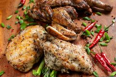 Grilled chicken laid out on a wooden board. royalty free stock images