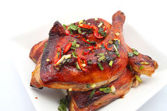 Grilled Chicken leg with chillies Royalty Free Stock Photos