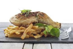 Grilled chicken leg and french fries with salad Royalty Free Stock Images